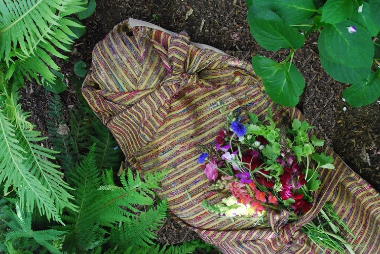 green burial body in a natural shroud